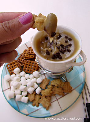 Cookie Dough Fondue {warm cookie dough dip} on a plate with woman dipping a cookie