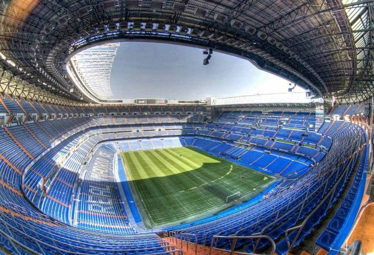 Travel around spain madrid for football fanatics for Puerta 6 estadio newells