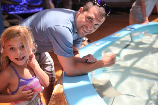Father and daughter enjoy the touch tanks at the Marine Science Center in Daytona