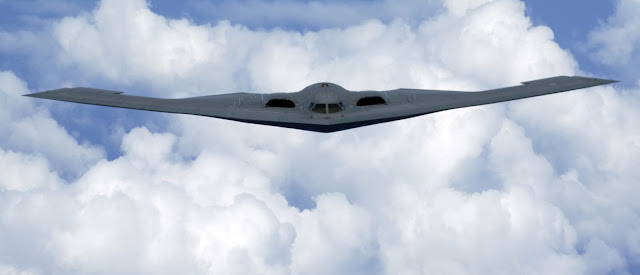 A B-2 Spirit soars through the sky after a refueling mission