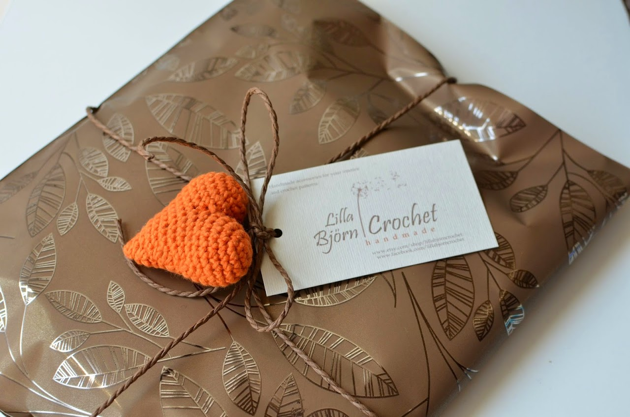 Handmade gift wrap with crocheted heart