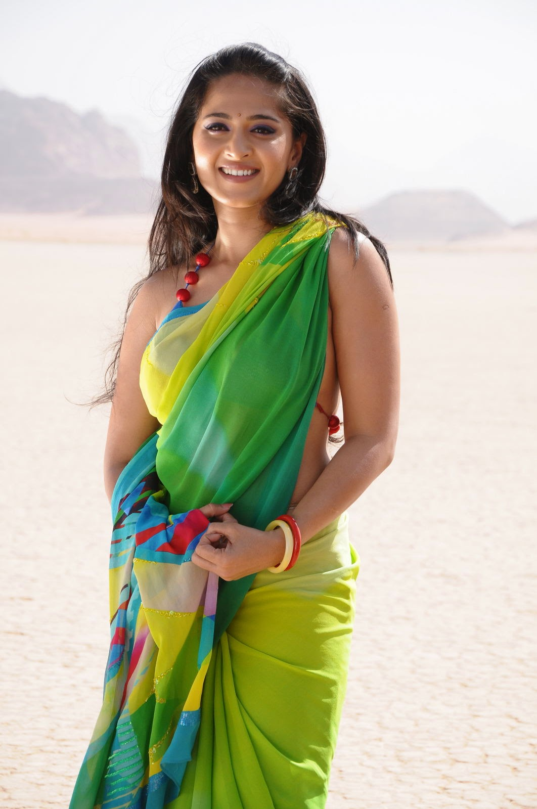 Gorgeous Anushka Shetty in Parrot Green Saree and String Blouse