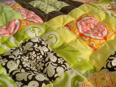 Hand tying Meadowsweet quilt.  Fabric by Sandi Henderson for Michael Miller.