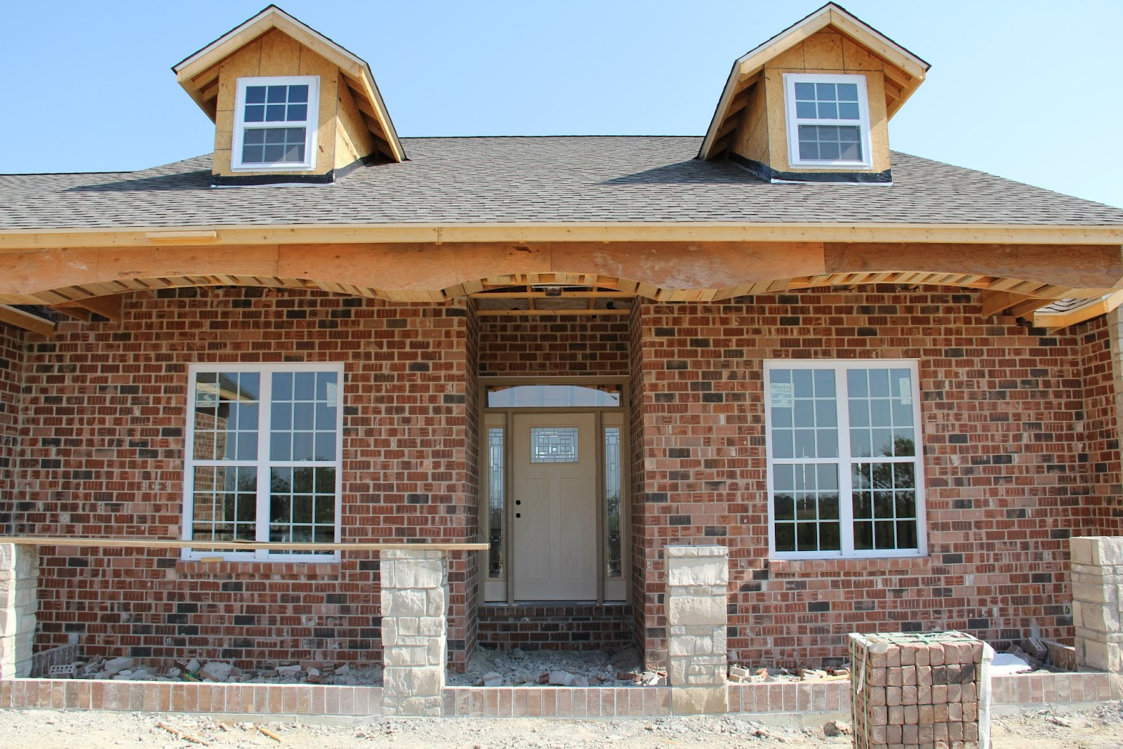 Our new home the exterior brick stone and siding for Brick exterior design