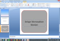 memasukkan wordart pada slide