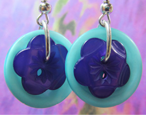 Drop dangle earrings have cute purple flower buttons layered over light teal buttons