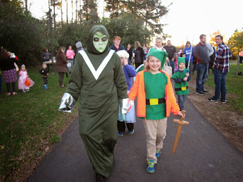 The Alien Leads Children in a Parade at Thompson Park