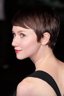 Valerie Curry, polished pixie cut.