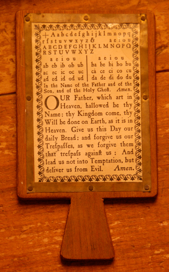 A hornbook showing Christ's cross, the alphabet, and the Lord's prayer