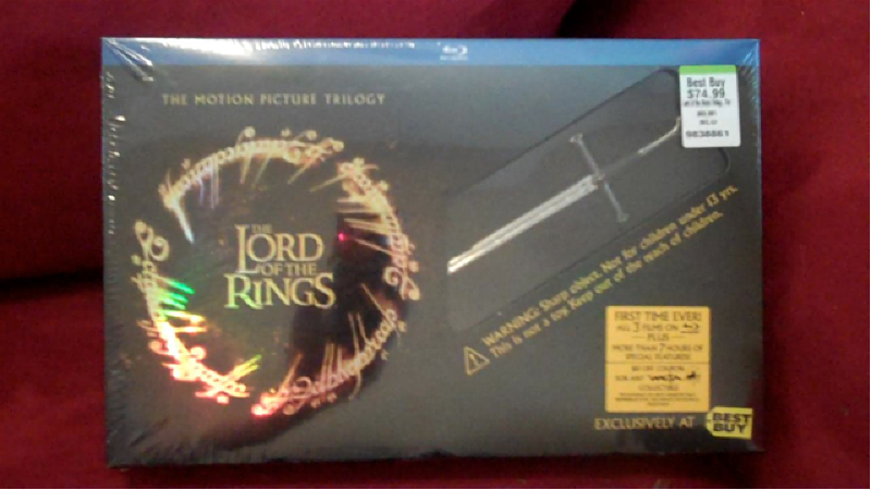 the best buy exclusive for the lord of the rings the motion picture trilogy includes a anduril sword letter opener in a special keepsake box