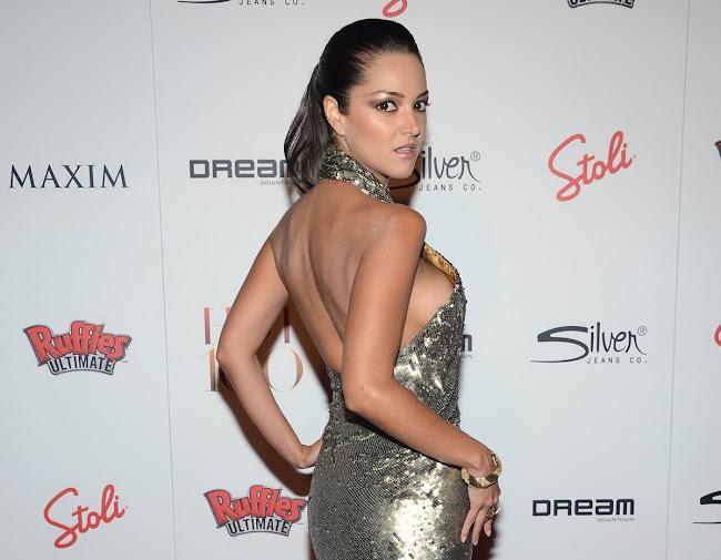 PAULA GARCES in a silver dress at Maxim Hot 100 Party
