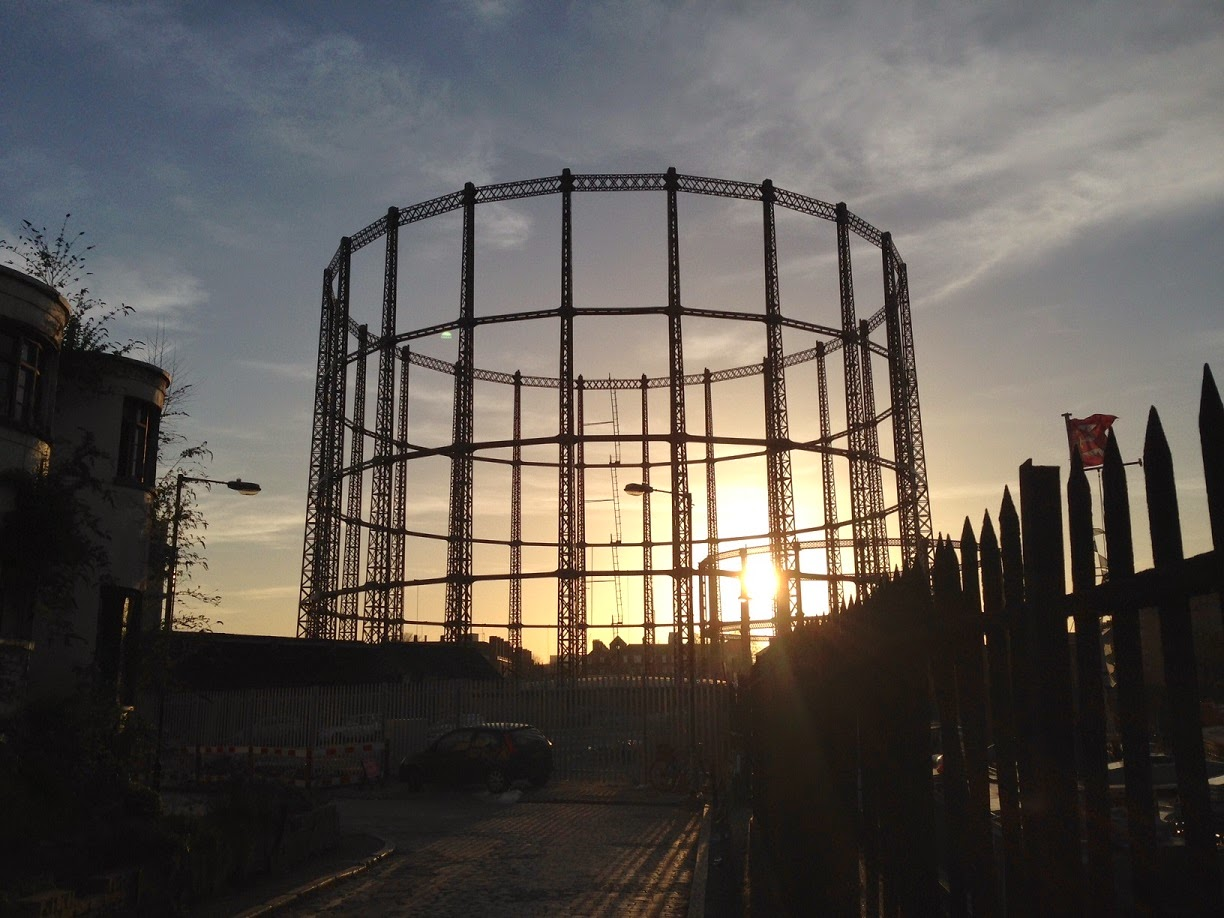 Sun setting over Hackney gasworks, London E2