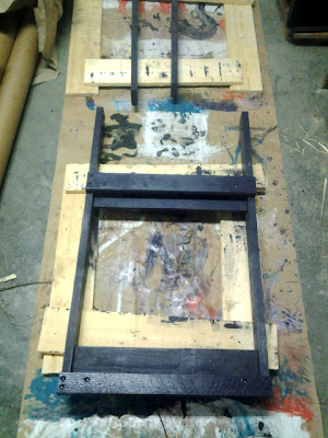 first step toward framing, front and back frames are painted on end grain and countersink holes