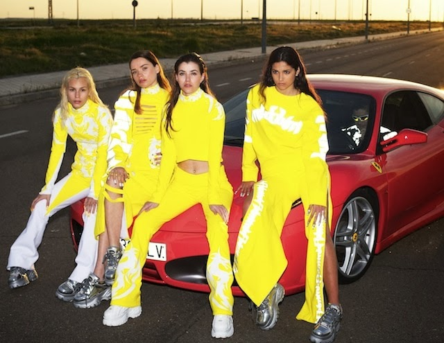 Girls in almost-matching yellow outfits, leaning on a red sportscar, 90's, chunky sneakers, long hair