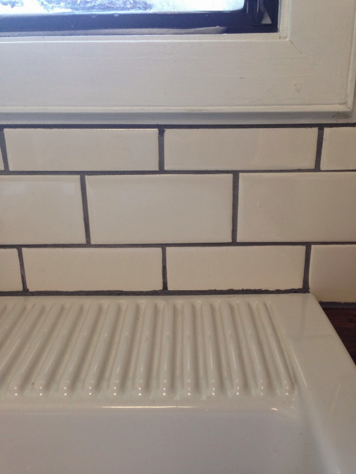 The dabbling crafter diy sunday ugly house subway tile we had thought we had a good cut here but not so much were replacing all the outlets with white and when we do that well get a oversized cover to dailygadgetfo Choice Image