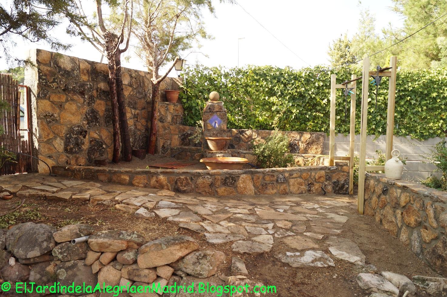 diseo y realizacin de muros de piedra en la entrada al jardn