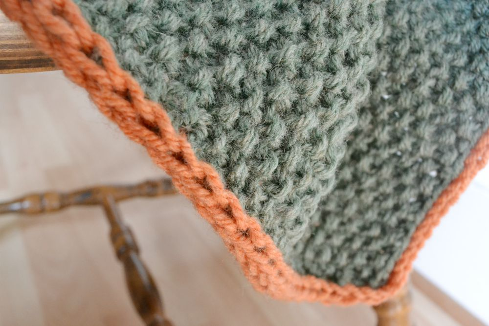 i-cord knitted edging baby blanket green orange