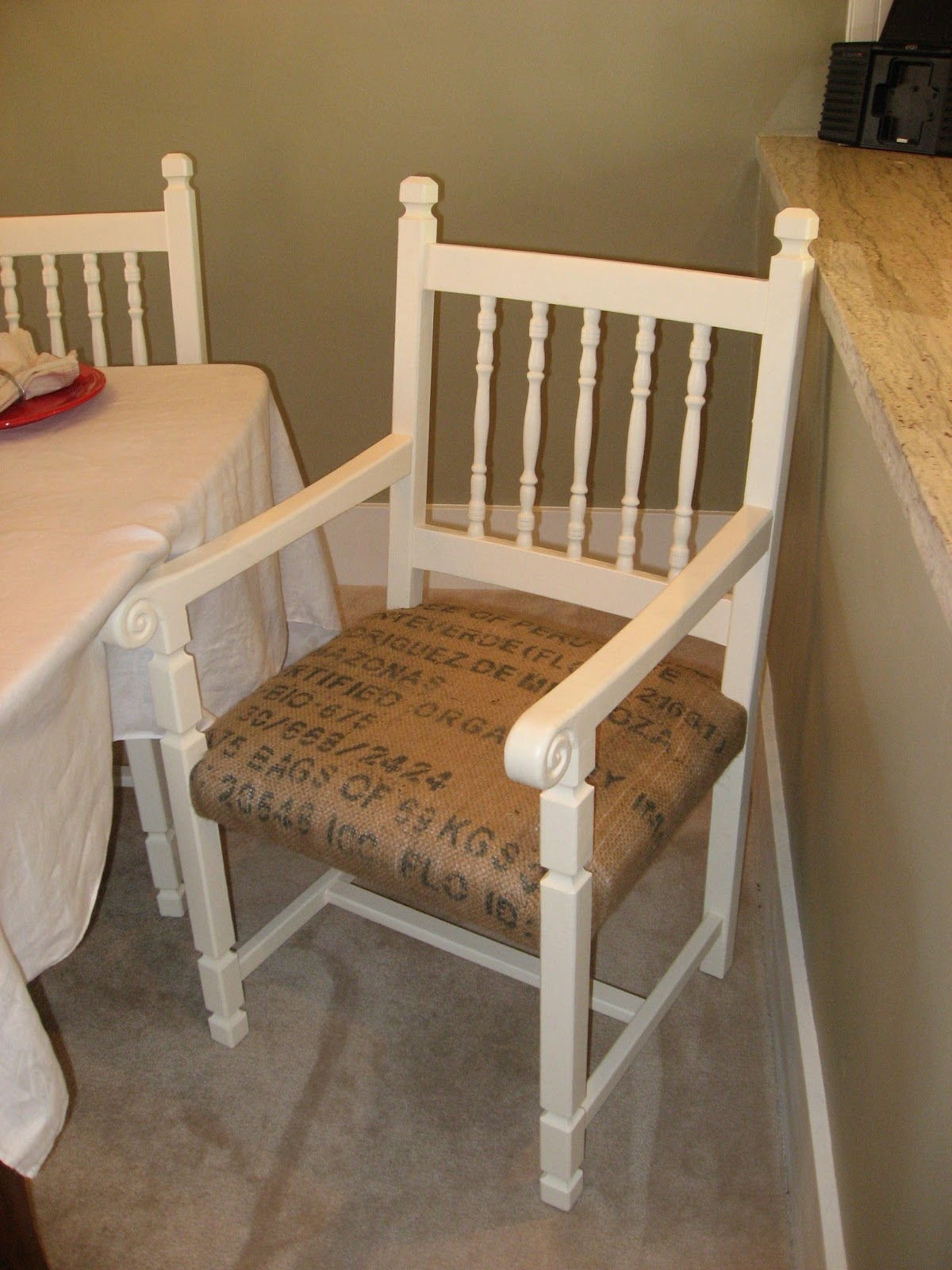 Creations dining chairs upholstered with burlap coffee sacks
