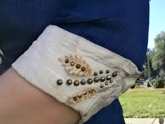 lace and studs on 30s-40s vintage jacket sleeves