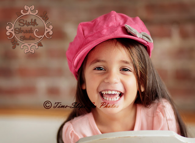 laughing_girl_in_pink_hat