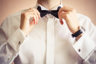 Man tugging at his bow tie