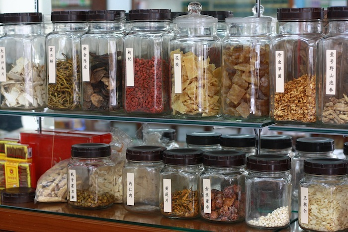 glass jars of chinese medicine and herbs in a chinese medical hall in penang