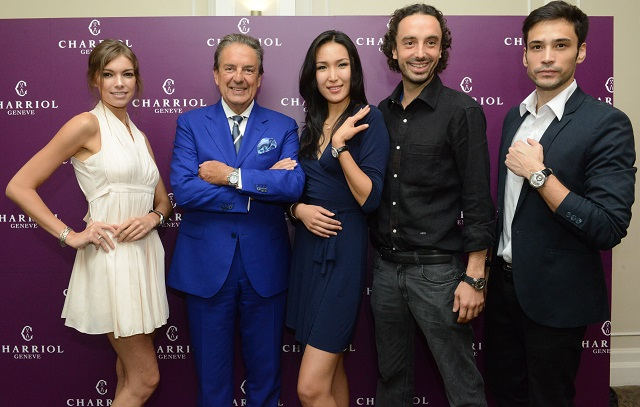 Mr Phillipe Charriol, founder and owner of Charriol, and his son Alexandre Charriol with the models