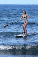 Ireland Baldwin paddle boarding in the ocean