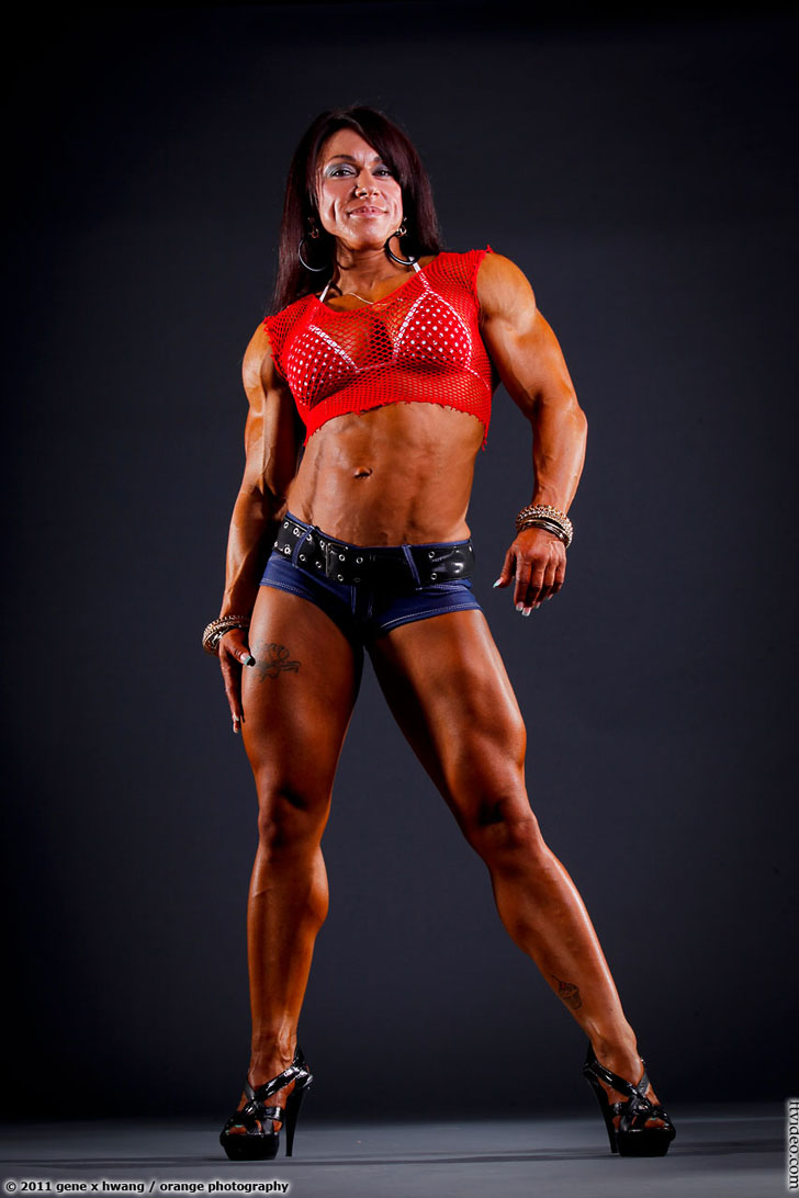 Carla Rossi Modeling Her Shredded Muscles In Heels