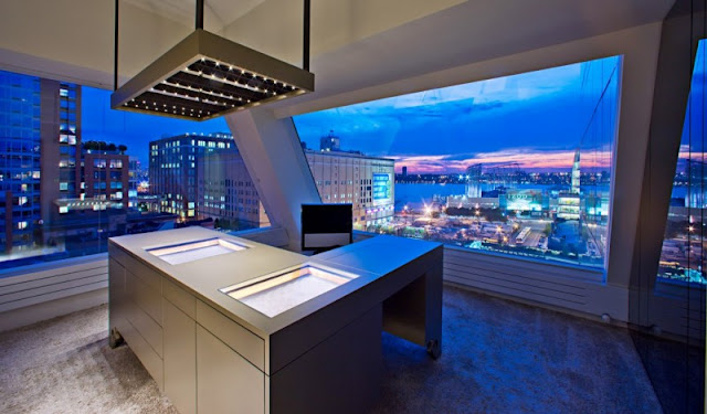 Photo of working room with incredible view in one of the modern New York penthouses