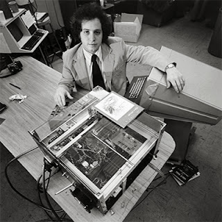 Ray sitting at a desk with a large printer-like machine