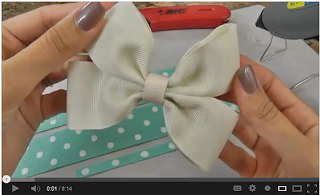 ... she shows you how to make a pinwheel hair bow. Too cute for words