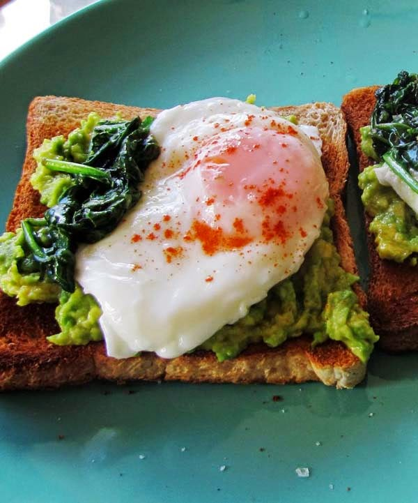 Open-Faced Toast with Poached Eggs, Mashed Avocado and Buttered Spinach. Simple Breakfast Idea To Use Leftovers.