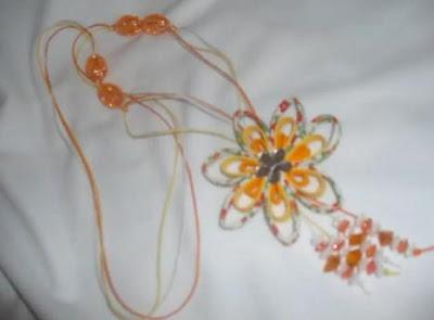 Como hacer flores con cintas al bies