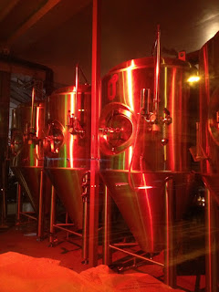 picture of beer vats with red lighting
