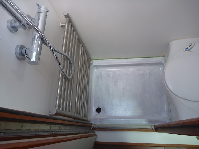Fibreglass repairs to motorhome shower tray after fairing and priming
