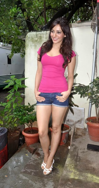 Neha Sharma in pink tight top wearing her blue jeans shorts in her vanity van