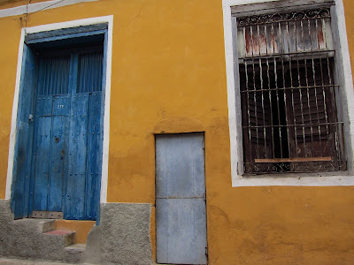 Santiago de Cuba yellow house blue door