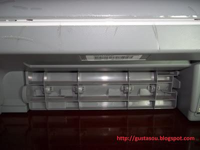 Impressora HP tampa de acesso traseira.