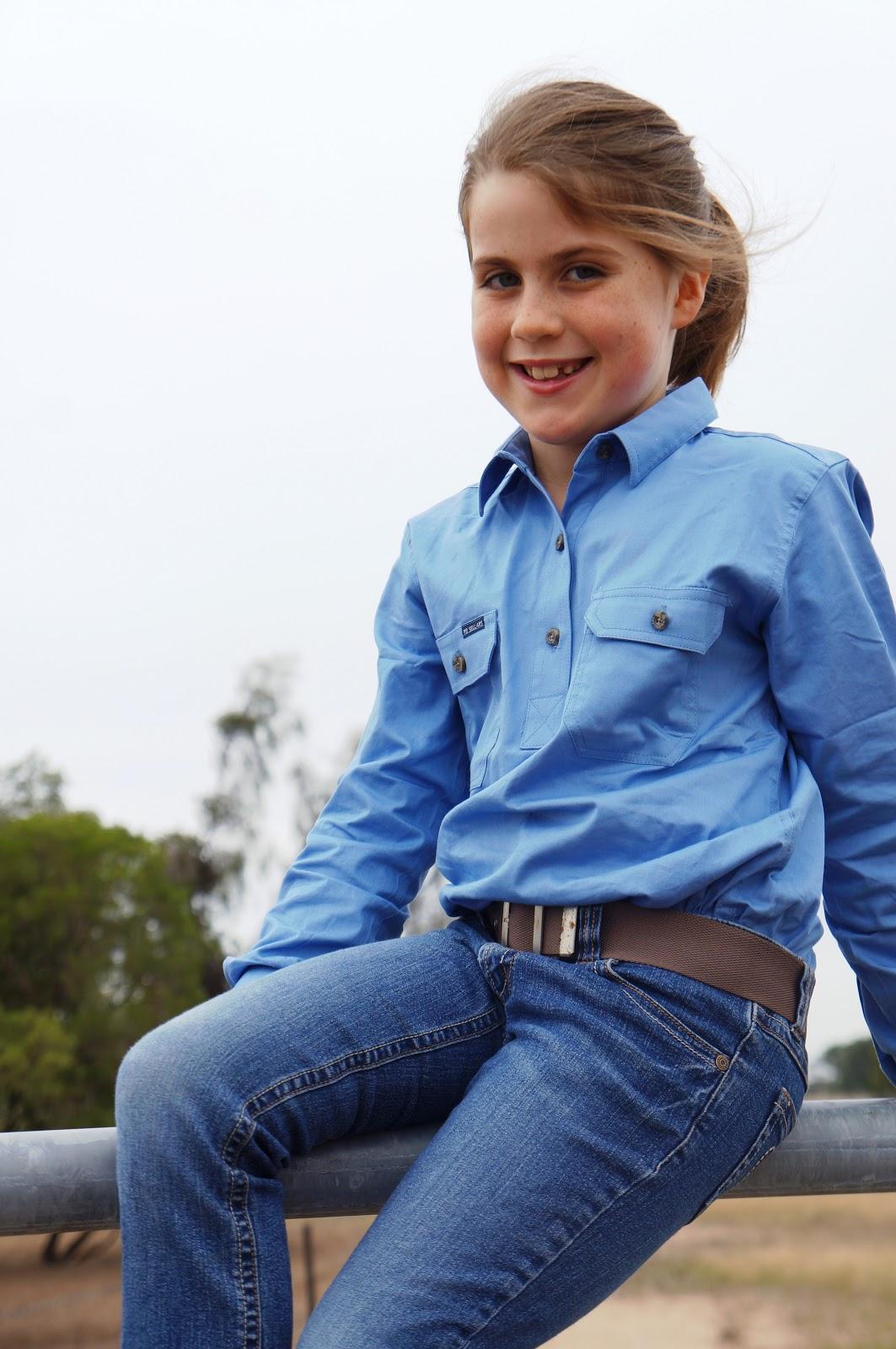 miss 8 in light blue work shirt