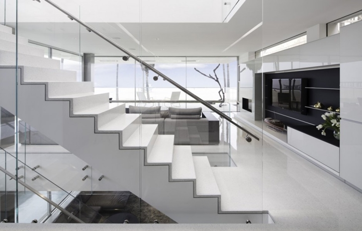 Stairs in Modern mansion on the beach by Dan Brunn