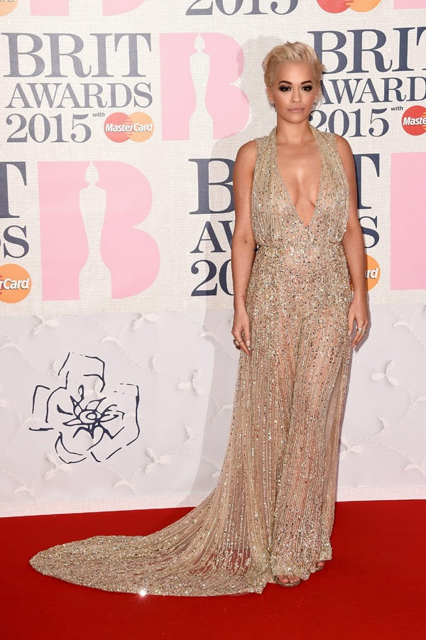 Rita Ora wears a plunging sequinned dress to the 2015 BRIT Awards in London