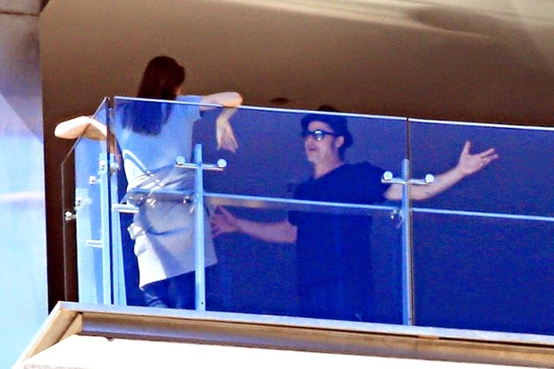 Angelina Jolie and Brad Pitt have serious conversation on hotel balcony