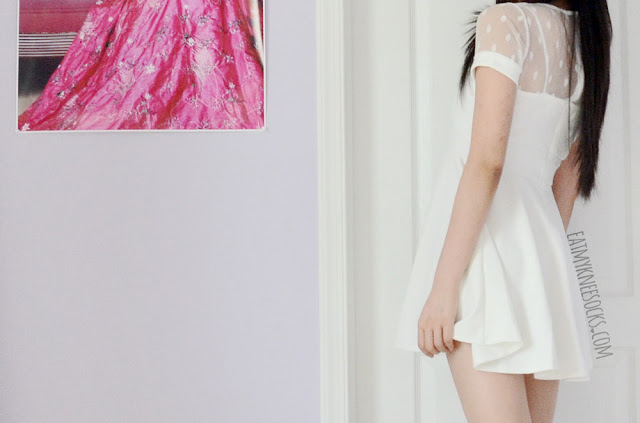 Yumart's white mesh polka dot fit-and-flare dress has a lovely skater silhouette and sweetheart neckline.