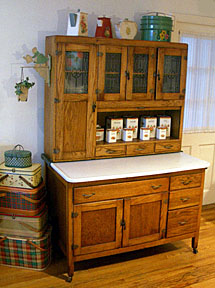 The Typical Hoosier Cabinet Had Three Sectionsu2014a Bottom Section, Featuring  One Large Compartment With A Slide Out Shelf And Several Drawers To One  Side, ...
