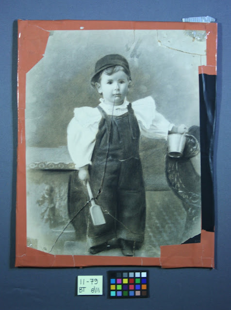 damage to old photograph, antique photograph tear, art conservator needed.