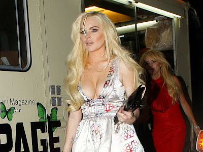 Lindsay Lohan in shimmering low cut dress
