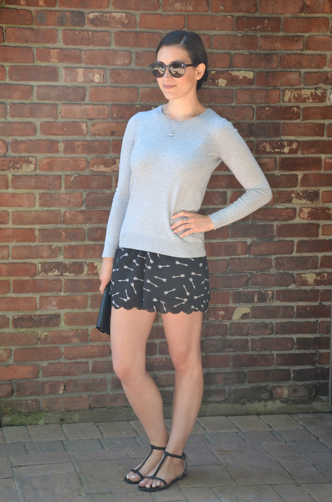 gray sweater + arrow shorts