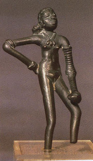 Dancing Girl, bronze, Mohenjo-Daro, Indus Valley, ca. 2500 BC  Perhaps the most famous figure of the Indus Valley civilization. Her right arm bears two bangles and an armlet, very simple of design, whereas her left arm is covered with bangles. Her necklace has three cowrie shell pendants.
