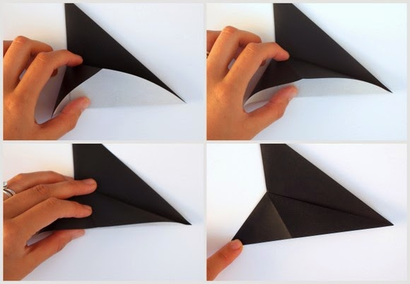 fold origami paper to make a sideways star-trek sign